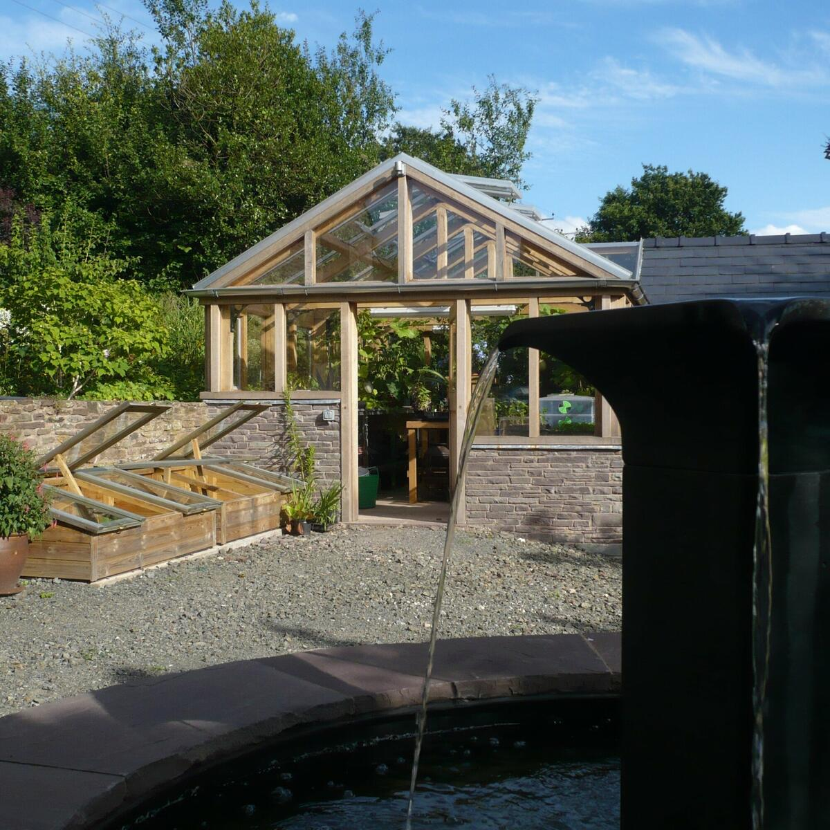 William Pye water feature and greenhouse