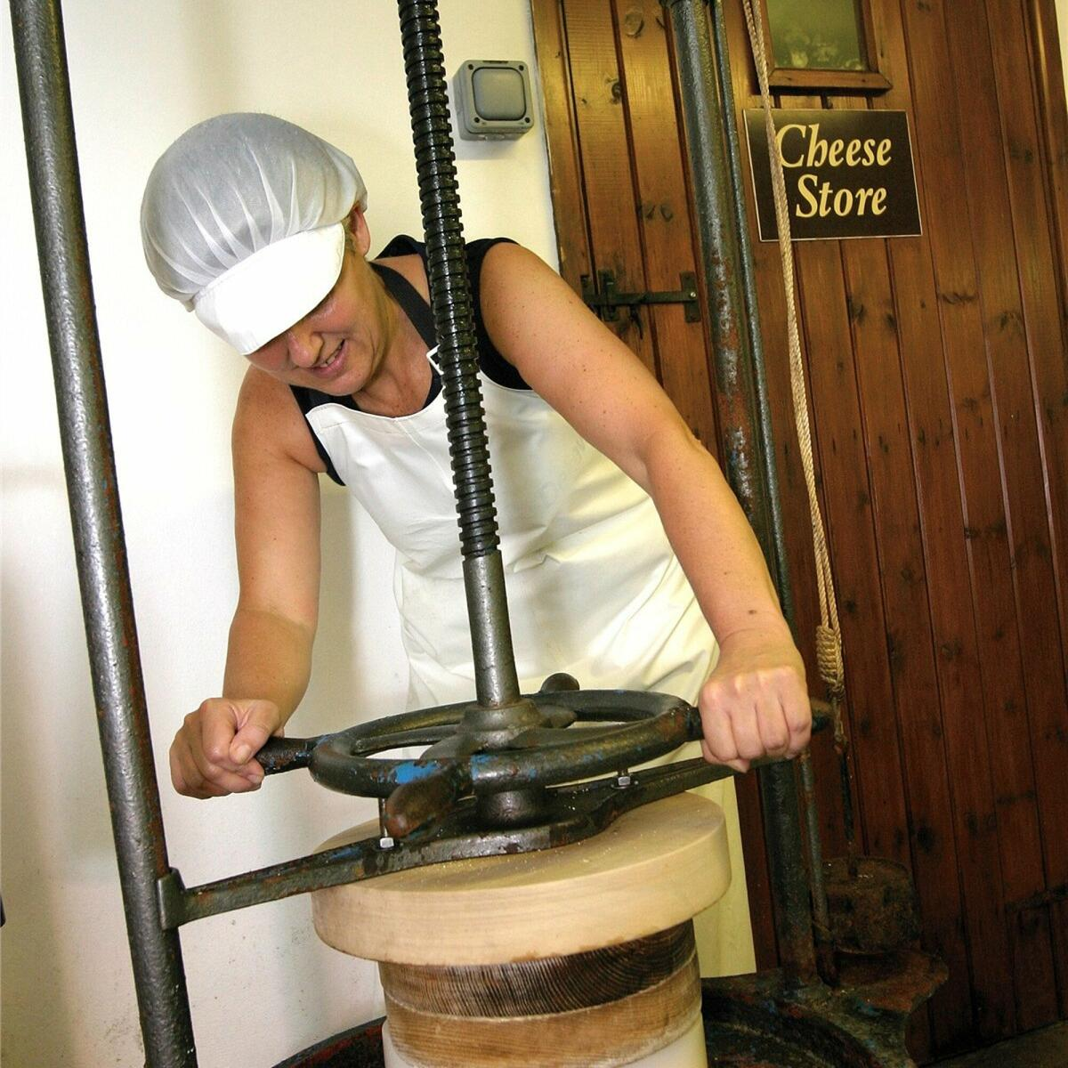Pressing the cheese.