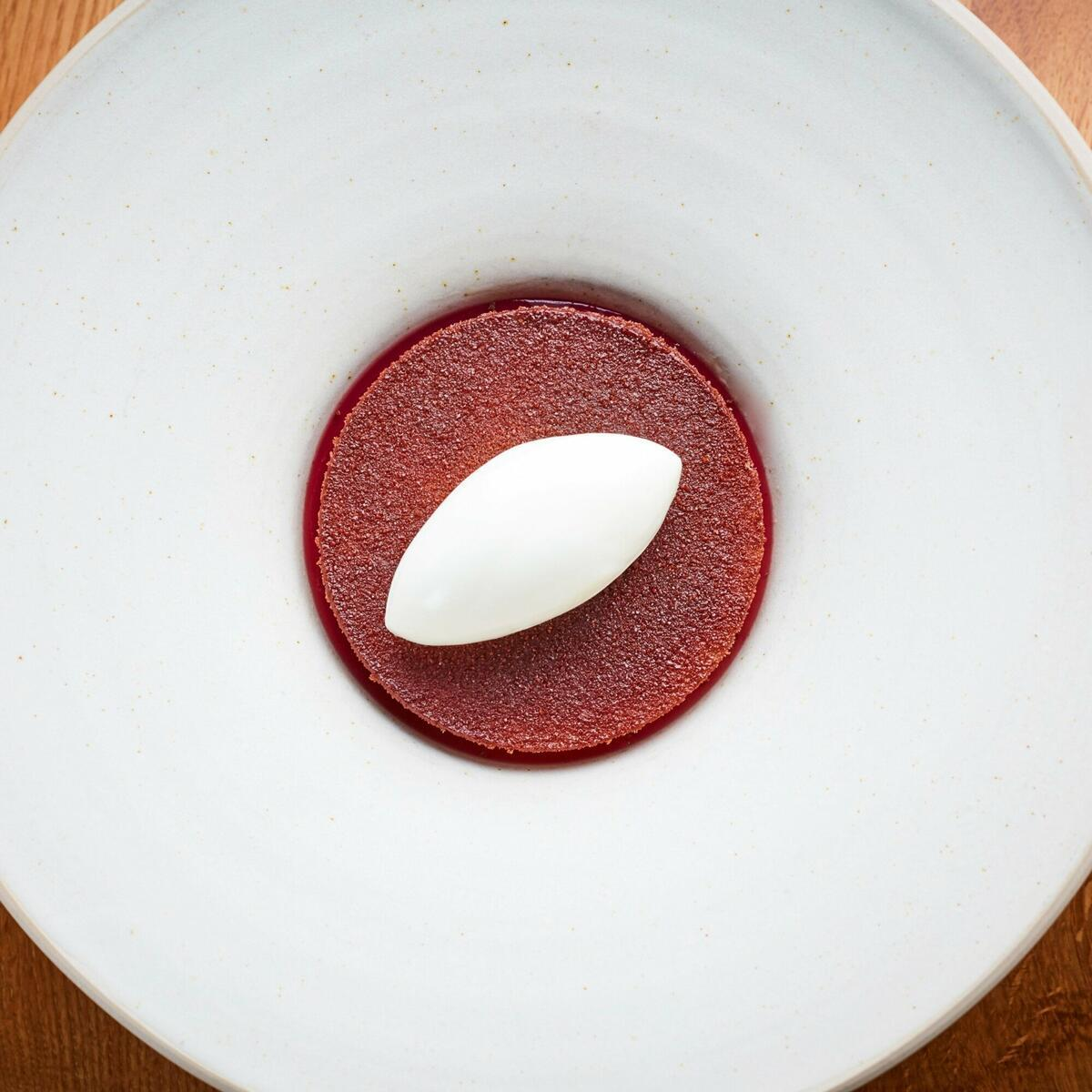 Mulled red wine pear, vanilla panna cotta, gingerbread, yoghurt sorbet by Jodi Hinds