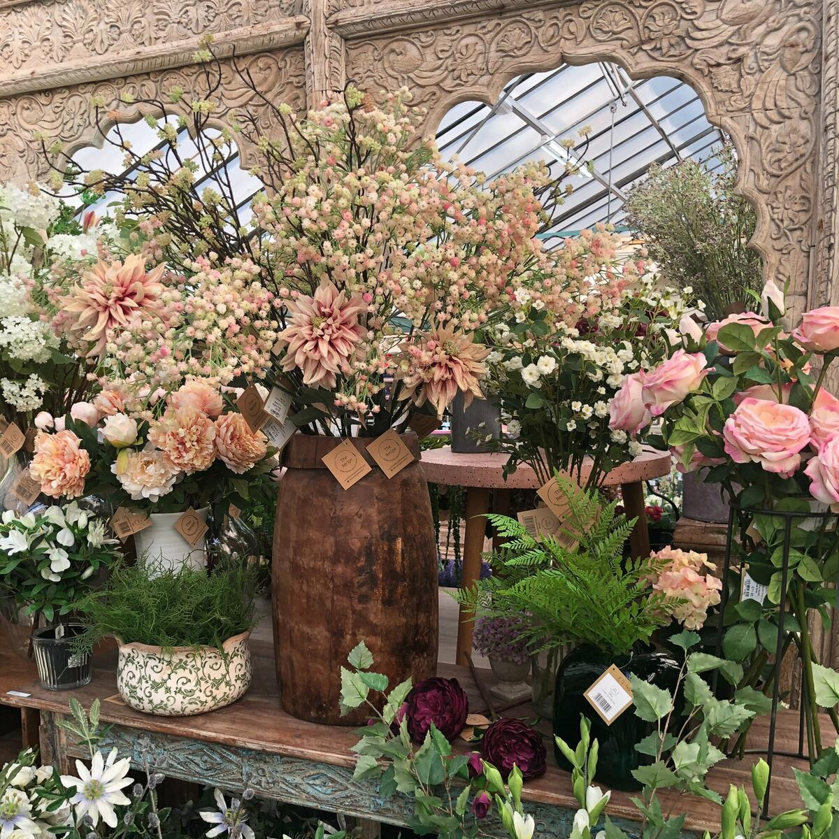 Silk flowers looking lovely against the salvage.