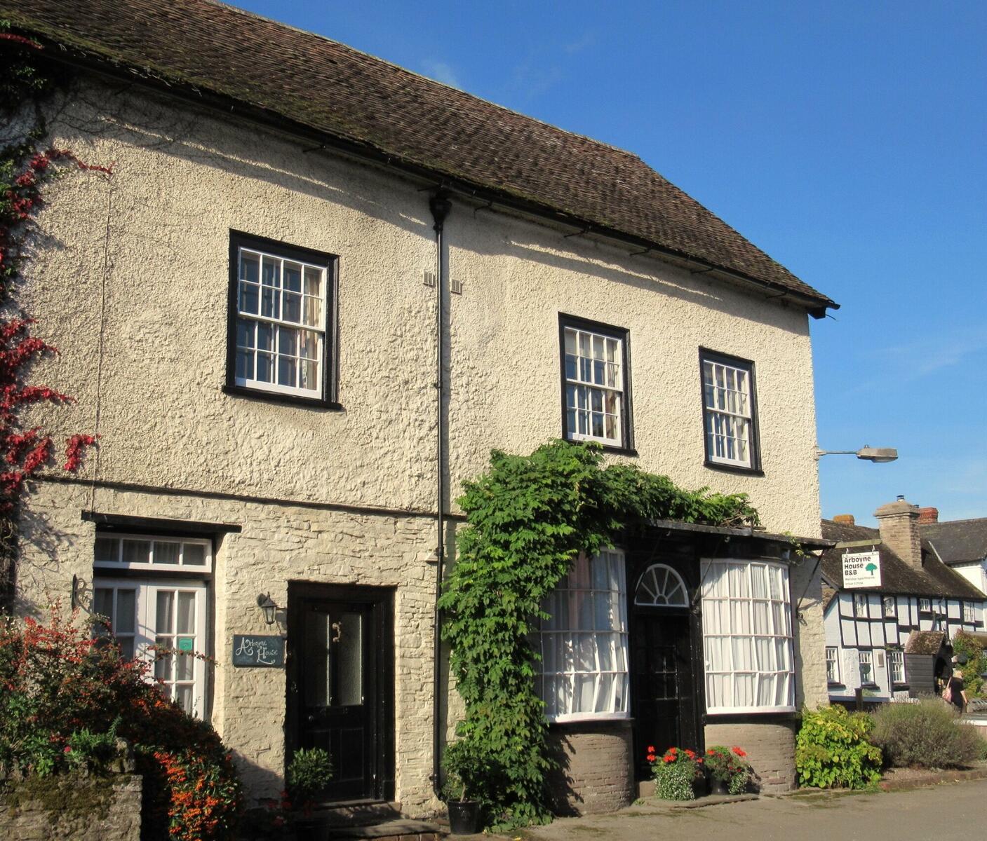 Arboyne House is a listed building and has Georgian shop windows.