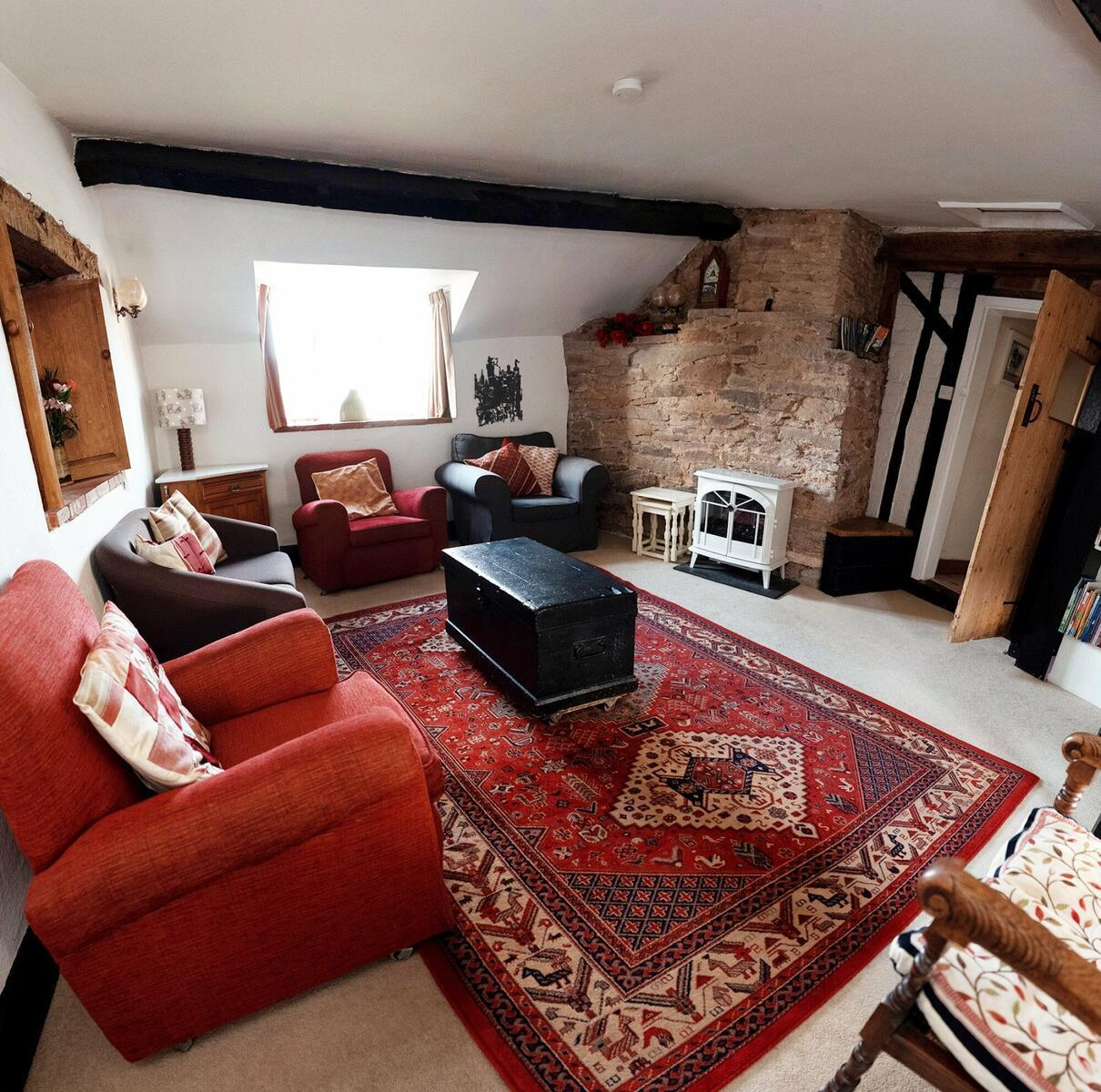 The light and spacious living room in Holly Lodge.