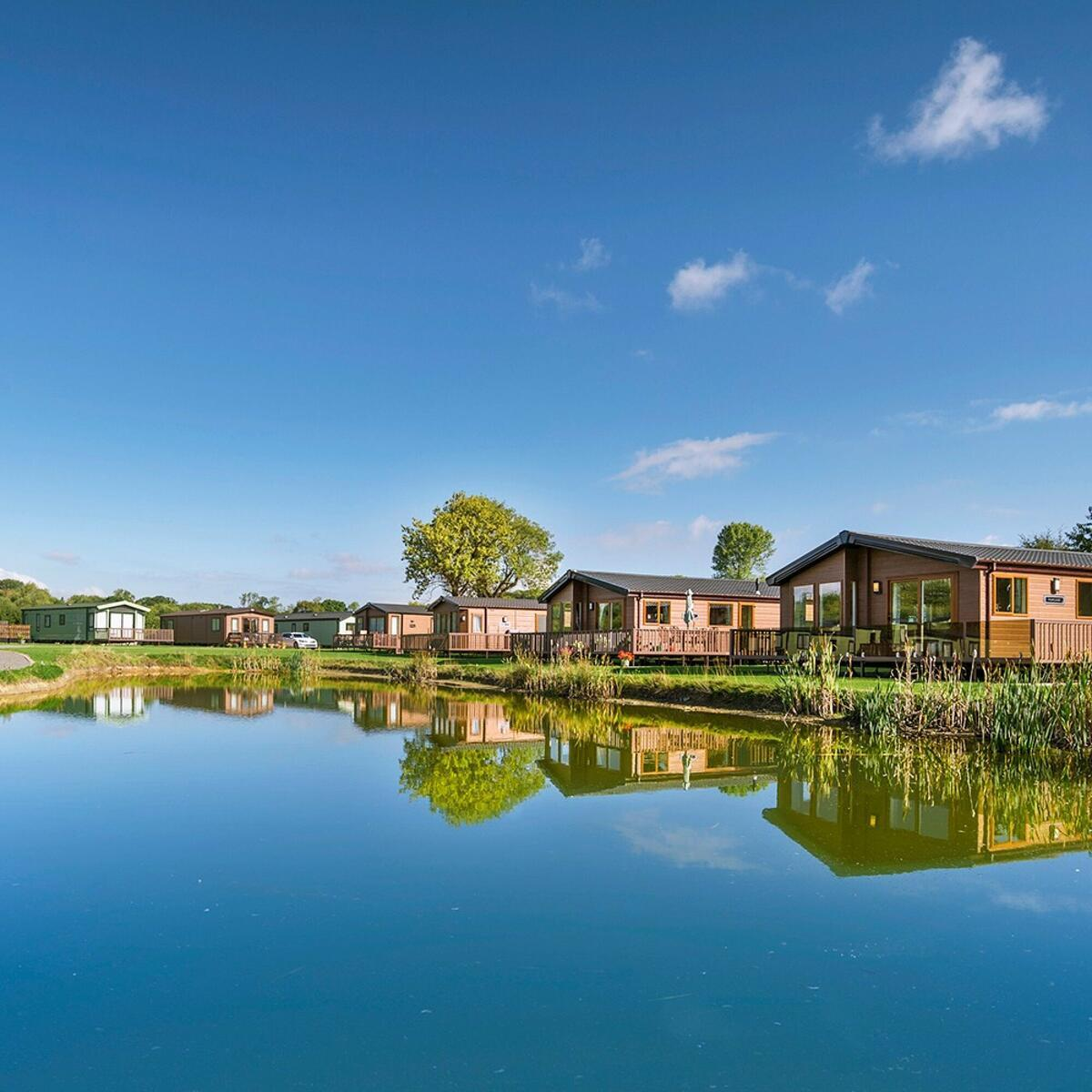 Privately owned lake edge holiday lodges at Arrow Bank