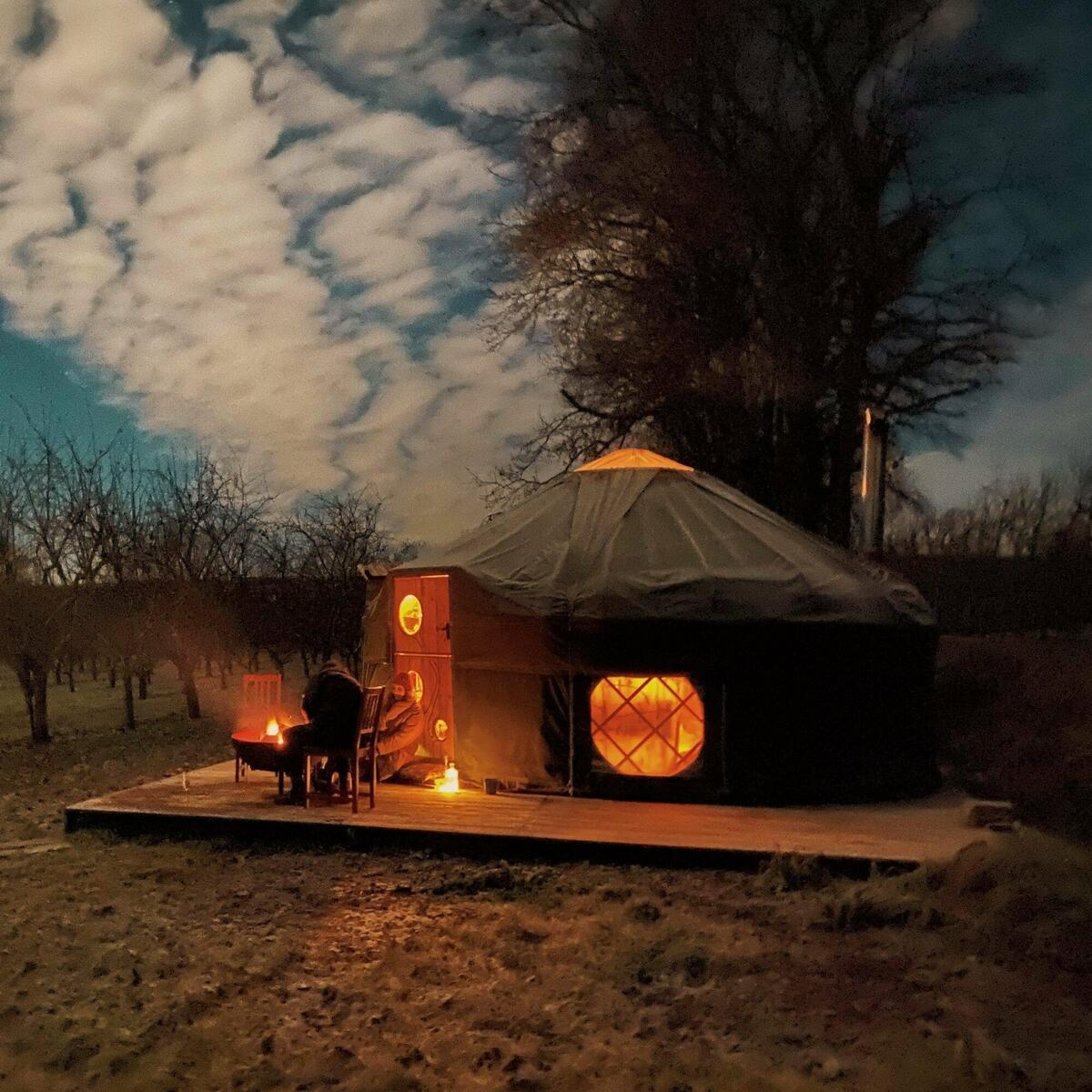Yurt with Fire bowl at night
