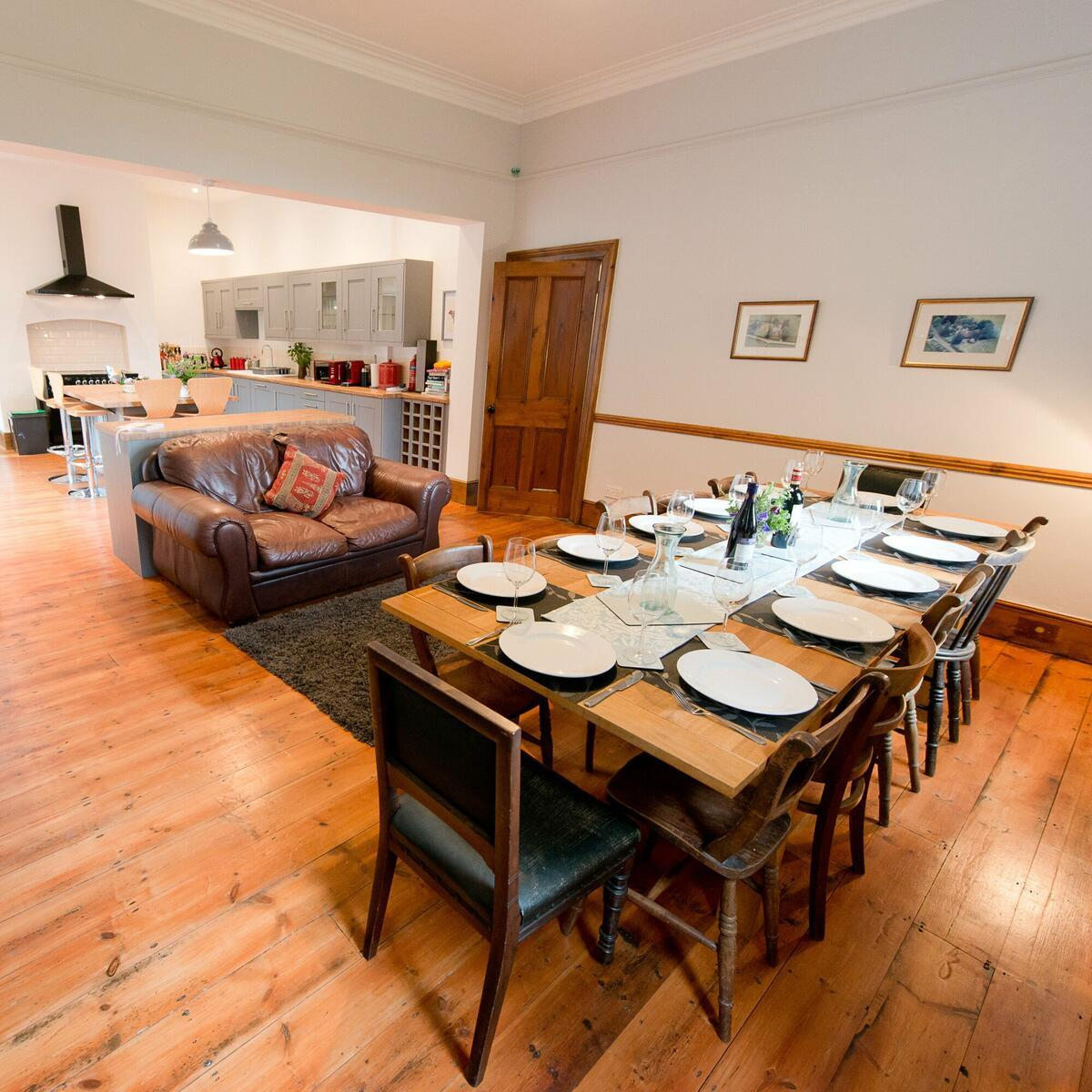 Dining room table easily seats 12 around the wood burner