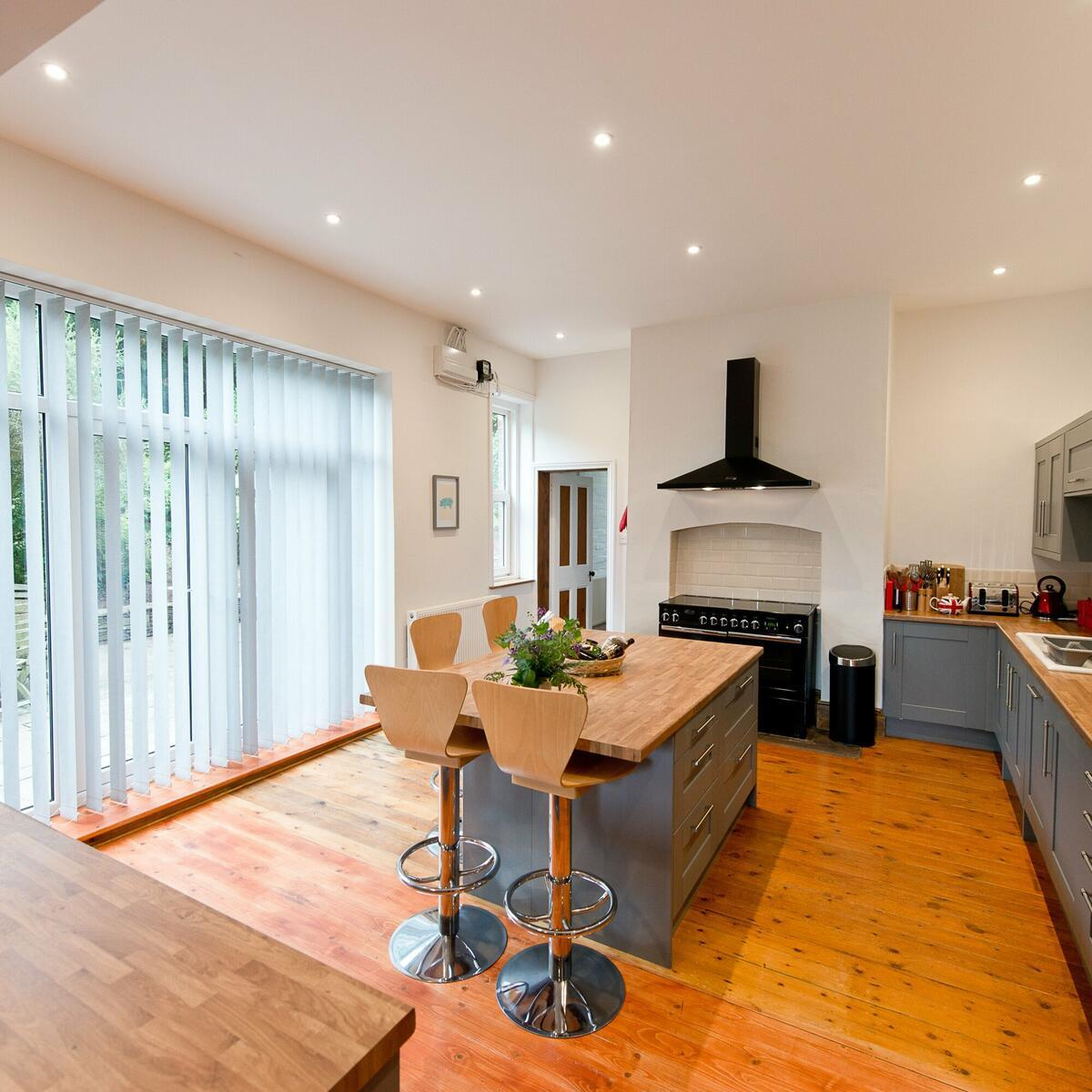 The open plan kitchen opens out onto the patio