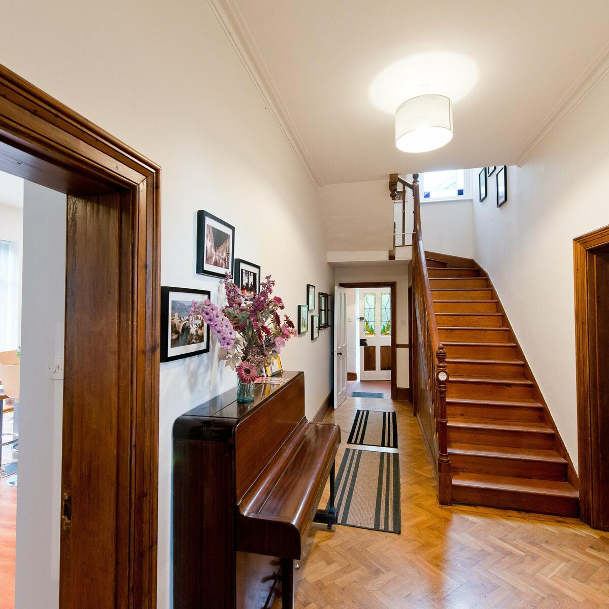 The piano may not be in tune but it fits in with the classic wooden decor