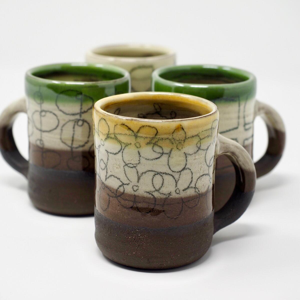 Sheila Herring  Black Earthenware Mugs