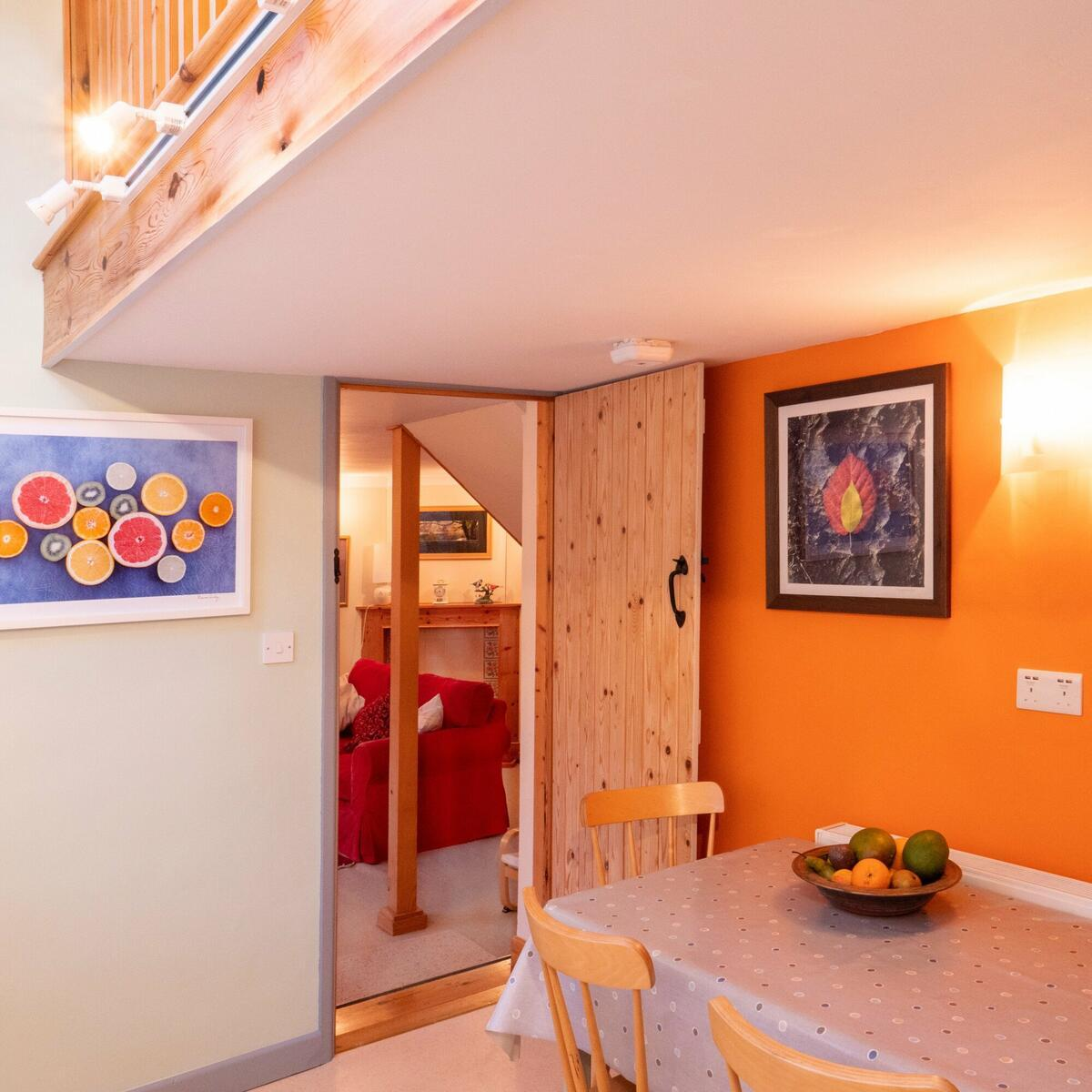 gallery over the kitchen, with luscious orange wall...