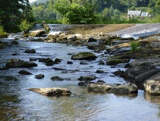 The river running by Riverside Inn, Aymestrey
