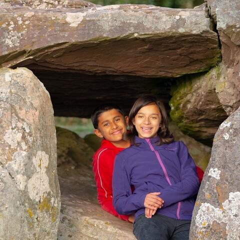 Children playing underneath Arthur's Stone